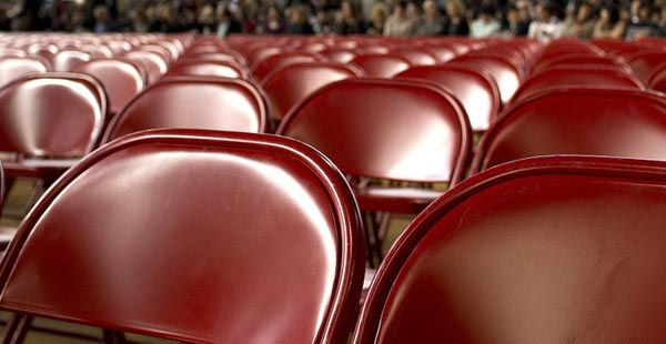Red chairs meant to convey the anticipation and trepidation of reading in front of a large audience