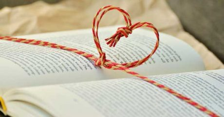 Best gifts for writers and poets [photo: book with heart-shaped bow]