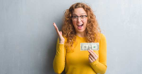 Journals that will pay you [photo: excited woman holding a dollar]