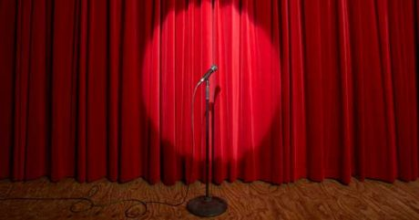 Workshop on how to read your work for an audience [photo: spotlit microphone on a stage]