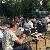 Around a dozen writers hard at work on the Artisplein